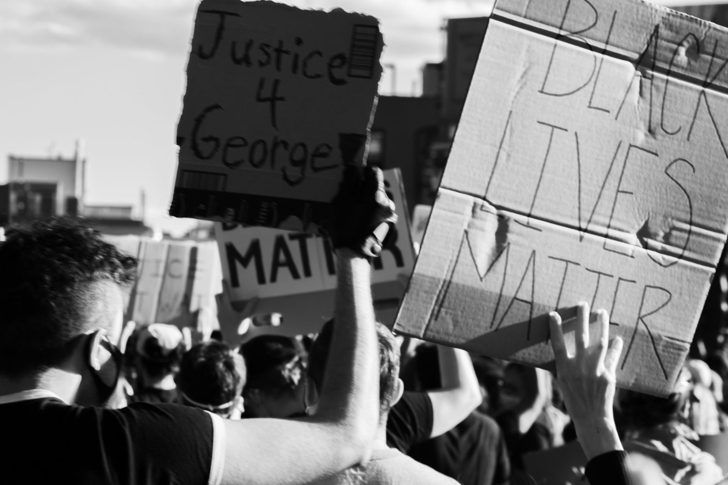 black lives matter signs held up during a protest